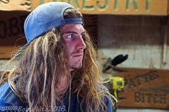 Patti's Bitch (Vurnman) Tags: california norcal nevadacounty grassvalley nevadacountyfair countyfair fair summer longhair hippie man hat carving wood