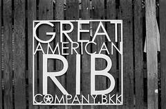 Great Ribs (35mm) (jcbkk1956) Tags: food american bangkok thailand 35mm film analog ribs restaurant nikon nikkor 50mmf2 ilfordpan100 sign mono blackwhite manual gate worldtrekker