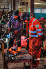 Steve waits with the tongs while Edd heats the rivets using a propane torch (Doddle Bug) Tags: 2 heritage train tank engine railway loco somerset class steam east locomotive preserved mallet 262 lms cranmore 262t shepton ivatt 41313 2mt