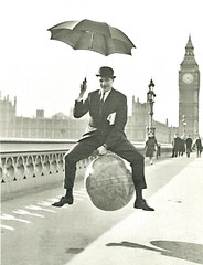 Englishman On Space Hopper (mrsris) Tags: postcard blackwhite spacehopper bigben englishman bowlerhat umbrella housesofparliament