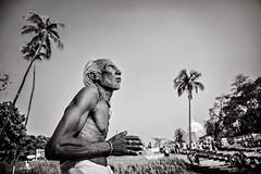 The Priest (Amlan Sanyal) Tags: india incredibleindia prayer praying blackandwhite streetphotography siliguri amlan people candid