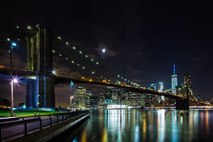 Brooklyn Bridge At Night (Jakub Slovacek) Tags: america brooklynbridge eastriver freedomtower manhattan nyc newyork oneworldtradecenter usa architecture bridge building city cityscape clouds downtown landmark lights longexposure night river sky skyline skyscraper tiltshift travel water
