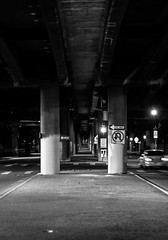 One way (Blockshadows) Tags: architecture industrial sharp canon50mmf12 canon 50mmf12 50mm12 50mm streetphotography colorado grimey grime sketchy moody somber monochrome blackandwhite bw bnw white black motionblur greenlight streetlights oneway symmetrical pillar pillars denver downtown urban city nightowl nightphotography nightscape longexposure lights streetsigns street symmetry tunnel bridge underpass