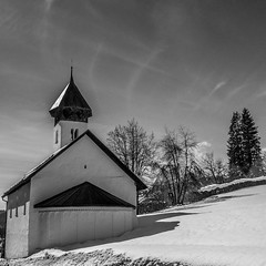 The Church at Fidaz (David Crook) Tags: blackandwhite mountain snow alps church pen easter mono switzerland olympus flims ep1 fidaz