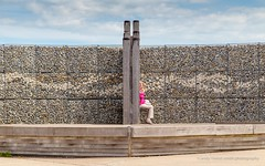 Woman sitting (andythekeys) Tags: summer england woman kent sitting harbour whitstable sideon