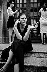 On the Steps of the Economics University (stimpsonjake) Tags: nikoncoolpixa 185mm streetphotography bucharest romania city candid blackandwhite bw monochrome students university girls cigarette phone steps