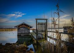 Boathouse (Lothar Schuelein) Tags: bridge blue sky lake reed clouds landscape bayern see nikon stage cottage landing shore boathouse chiemsee schilf steg bootshaus bootshtte rimsting footbrigde d5100 landschafthtte