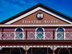 The Theatre Royal in Nelson (Steve Taylor (Photography)) Tags: wood blue roof newzealand sky sculpture brown white man building men art window face architecture digital fun happy gold theater sad theatre balcony royal nelson nz mauve southisland railing outline weatherboard