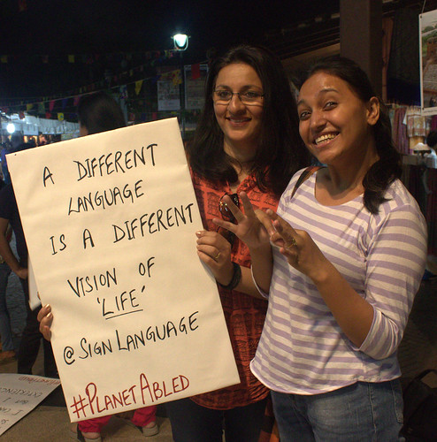 Poster Campaign: Rupmani who is Deaf with the Sign Language Interpreter (holding the poster).