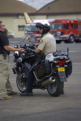 Security (swong95765) Tags: motorcycle police security gun weapon bike airshow protection