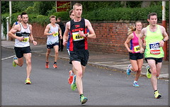 Nine miles stll to go (* RICHARD M (Over 5 million views)) Tags: street action sport southporthalfmarathon halfmarathon runners running racing roadracing roadrunners athletes athletics sportsmen sportswomen roadrunning longdistancerunners longdistancerunning endurance effort determinaton determined focused inthezone dhrunners pennylanestriders sports shorts runningshorts legs sportswear truegrit southport sefton merseyside vests trainers sneakers stridingout