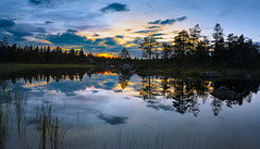 Sunset Mirrored in Purple (photomatic.se) Tags: ifttt 500px dalarna sweden water sunset lake summer trees beautiful reflection light blue yellow orange no people
