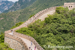 Mutianyu, China - Landscape view of tourists walking on the Great Wall of China. The wall stretches over 6,000 mountainous kilometers east to west across North China and through 15 provinces. (Remsberg Photos) Tags: asia china mutianyu eastasia beijing greatwall world greatwallofchina wonderoftheworld mountains architecture photography travel destination nature internationallandmark brick builtstructure ancient history protection culture fortifiedstructure province landscape beauty tourists chn