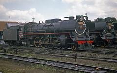 Krupp 2-8-2 Class D52's at Yogyakarta station, Indonesia.  July 1976 (Brit 70013 fan) Tags: germany indonesia java engine eisenbahn railway class steam german yogyakarta jogjakarta steamengine krupp 282 dampfmaschine d52