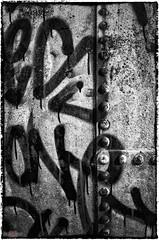 Rust, Rivets & Writing ... (sparkeyb) Tags: blackandwhite bw abandoned graffiti mono blackwhite nikon rust rivets sigma monotone dirty forgotten urbanexploration spraypaint graff rotten 1020mm exploration derelict smelly damp gastank urbex d7000 silverefex sparkeyb