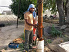 Man Restoring Power to Village Farm (IFPRI-IMAGES) Tags: india man fix wire village labor utility worker mend electrician necessity powergrid manoli haryana sonipat