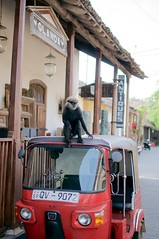 looking for a ride (amritfernando) Tags: road red building lights monkey pillar tuktuk numberplate trishore