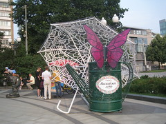Moscow Summer (VERUSHKA4) Tags: canon europe russia moscow city cityscape hccity boulevard tsvetnoy street decoration umbrella people ville vue view day jour sculpture child boy cloun bench verdur tree plant playing climbing butterfly house metallic object summer season july wateringpot lamp window