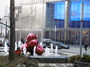 P1030682 (Mud Boy) Tags: nyc newyork fountain downtown manhattan financialdistrict batteryparkcity lowermanhattan 7worldtradecenter jeffkoonsballoonflowerred oversizedjeffkoonsballoonanimal