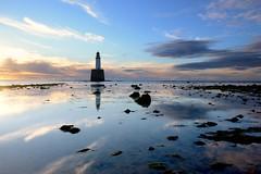 Sunrise reflections at Rattray Head Lighthouse (iancowe) Tags: lighthouse reflection beach rock sunrise dawn scotland sand aberdeenshire head scottish stevenson fraserburgh peterhead northernlighthouseboard rattray nlb rattrayheadlighthouse