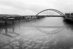 Cloudy Water (TnOlyShooter) Tags: nashville tennessee koreanveteransbridge shelbystreetpedestrianbridge cumberlandriver fog blackandwhite reflections olympusom1 olympusomzuiko28mmf35 findlab film analog