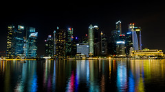 Singapores skyline at a glance (tekgator) Tags: singapore singapur river fluss travel reisen lake see colorful colors farben skyline water wasser waterfront city stadt night nacht alpha6000 sony sonya6000 marinabay marinabaysands light lightshow show fullerton