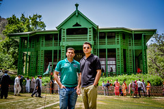 The Happy Two (lone_krusader) Tags: old trip flowers friends pakistan summer portrait sky people plants building green beautiful photoshop glasses photo nikon outdoor entrance style front adobe e enjoy dslr spectacles residency chill juniper quaid lightroom memorable flowersplants azam balochistan quaideazam ziarat d5200