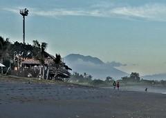 Bali - Keramas Beach & Mount Agung at Sunset (zorro1945) Tags: bali indonesia asia keramas beach mountain sunset sundown gloaming eveninglight nightfall duo boys lights bar restaurant flickrtravelaward mountagung volcano