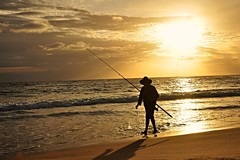 Sunrise Fishing (missgeok) Tags: sunrise fishing silhouette lightandshadow sunrisefishing morning weather day warm cronullabeach sydney australia nikon composition lighting colourtones horizon fisherman hat fishingrod beachfishing golden light sunshine walking