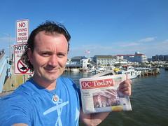 Ryan Janek Wolowski reading Ocean City OC Today Newspaper in Ocean City, Maryland, USA (RYANISLAND) Tags: summer beach md maryland beaches summertime oceancity oc atlanticocean worcester ocmd oceancitymaryland beachtown worcestercounty atlanticoceanbeach resorttown midatlanticregion townofoceancity
