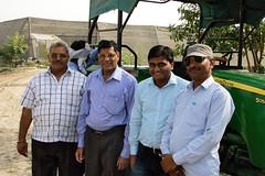 Sain Dass and Sunil Saroj Pose with Farmers (IFPRI-IMAGES) Tags: tractor smile pose village farm research farmer agriculture groupshot johndeere farmequipment manoli haryana farmtools sonipat foodsecurity ifpri saindass sunilsaroj