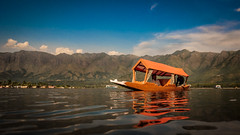 Kashmiri Shikara - Srinagar, India (Kartik Kumar S) Tags: sunset india lake water canon landscape photography evening boat transport culture dal transportation kashmir srinagar shikara dallake