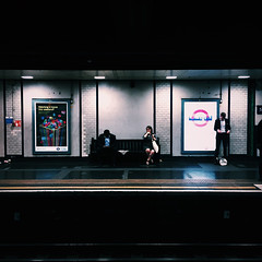 Alone (Olly Denton) Tags: city uk urban 6 london apple westminster night train bench underground subway lights evening mac transport tube platform commute stjamespark rails ios districtline commuters iphone vsco iphone6 stjamesparkstation vscocam vscolondon