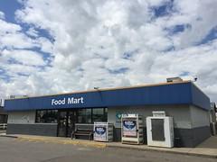 Blue Food Mart (Rock Water) Tags: blue sky clouds skies northdakota generic vernaculararchitecture conveniencestores rugbynorthdakota foodmarts