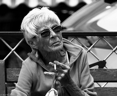 Am I too old to give up smoking ? (Neil. Moralee) Tags: street old uk people blackandwhite bw woman white black monochrome lines lady female mono glasses nikon hand close skin outdoor cigarette candid smoke neil shades devon mature age damage arthritis smoker reportage ageing wrinkled whitehair teignmouth crone crowsfeet gaunt whitehaired d7100 moralee