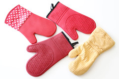 Group of red and yellow oven mitts (yourbestdigs) Tags: red food white hot cooking kitchen perfect hand oven arm background object cook wear safety eat burn heat worn glove positive safe protective protection prevention tool cookware mitten protect mitt prevent insulated bakeware scald insulating weared