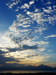 Day's last gasp (Roving I) Tags: sea sky sunsets nature bays cloud hills peninsulas danang vietnam vertical
