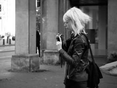 Get the picture! (danielsteuri) Tags: danielsteuri switzerland world streetphotography olympus omd em10 mft microfourthird 14mm 45mm blackwhite bw candid moments moment creativecommons explore scout bestcamera primelens portrait scene scenery strassenfotografie fotografie city snap photography street unposed crop streetmonkey flowingones camera blonde women standing adjust afternoon portraitstreet