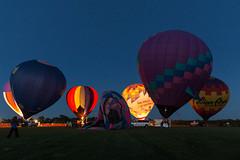 Pulling the Plug (too windy) (JasonMK) Tags: balloon balloonfest harvard colors sunset rainbow hotair hotairballoon