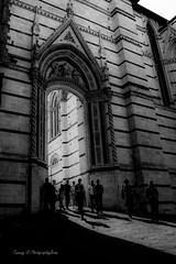 Through the gate of light (PhotographbyBram) Tags: siena italy itali zwartwit blackwhite bw light travel people duomo gate outdoor toscane tuscany shadow rayoflight architectuur architecture amazing sonyalpha
