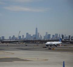 Newark to Manhattan (irishbartender) Tags: city nyc blue sky urban newyork tarmac airplane concrete newjersey airport nikon manh