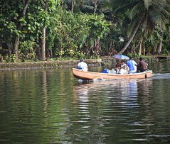 A Family Outing (The Spirit of the World) Tags: kerala india backwaters water reflections southernindia family dailylife lake boat trees palmtrees tropical powerboat waterscape waterreflections
