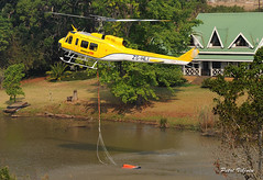 Helicopter Taking Water (Petri_) Tags: helicopter zshli workingonfire takingwater bucket dam reservoir house whiteriver mpumalanga southafrica nikond300s bell uh1d iroquois
