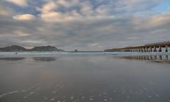 setting (Paul J's) Tags: ocean sunset beach pier pacific wharf eastcoast tolagabay