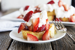 toasted pound cake with strawberries and whipped cream on a plate with a fork on a wood table (Berries.com) Tags: cake sharis dessert baking strawberry berries sweet strawberries treat bake pound