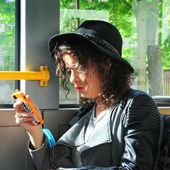 the indispensable tool (mujepa) Tags: portrait bus face hat mobile portable phone smartphone chapeau mobilephone texto tlphonemobile