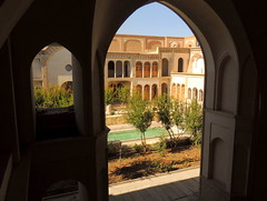Iranian palace courtyard from arched silhouette (Germn Vogel) Tags: asia middleeast westasia silkroad iran isfahanprovince kashan ameri palace traditionalhouse traditional architecture vernacular courtyard silhouette arch travel tourism