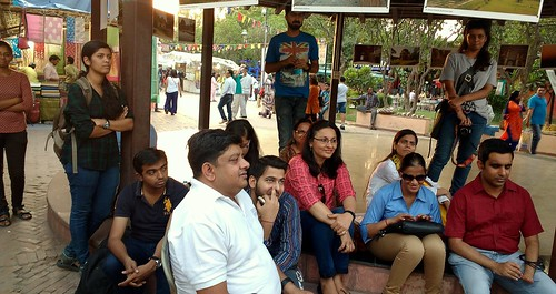 Poetry is thoughts that breathe and words that burn: People enjoying the poetry session held at Dilli Haat.