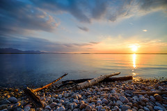 Sunset at Chiemsee (tompics78) Tags: chiemsee chieming sommer sonnenuntergang sony sonyilce7r see wasser himmel berge steine ufer treibholz wolken sonne sky sunset sun water beach clouds mountain 16mm