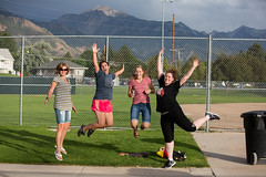 A couple great softballers and two happy fans! (Flickr_Rick) Tags: jump jumping jumpology outside summer mountains